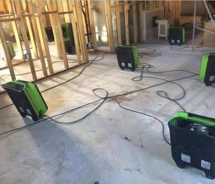 Water damage in Ogden, UT basement. Air movers were placed to speed up the drying process.