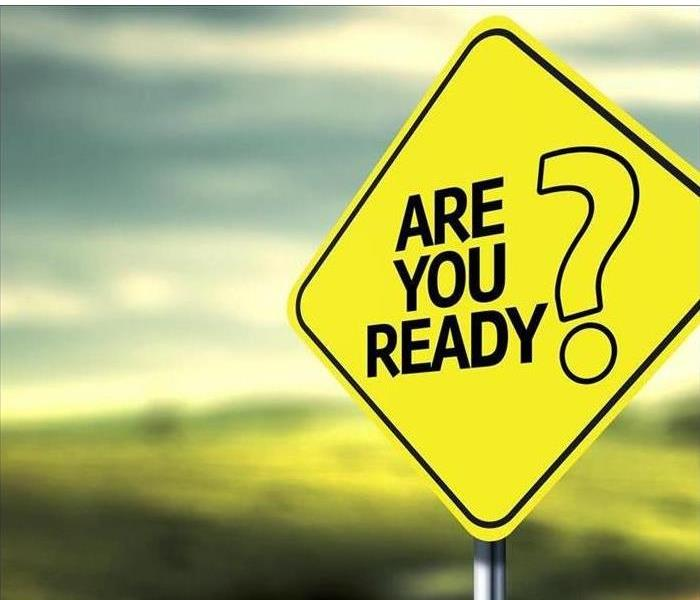 "Street sign with letters saying ""Are you ready?"""