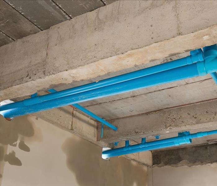 Image of water pipes in a crawlspace